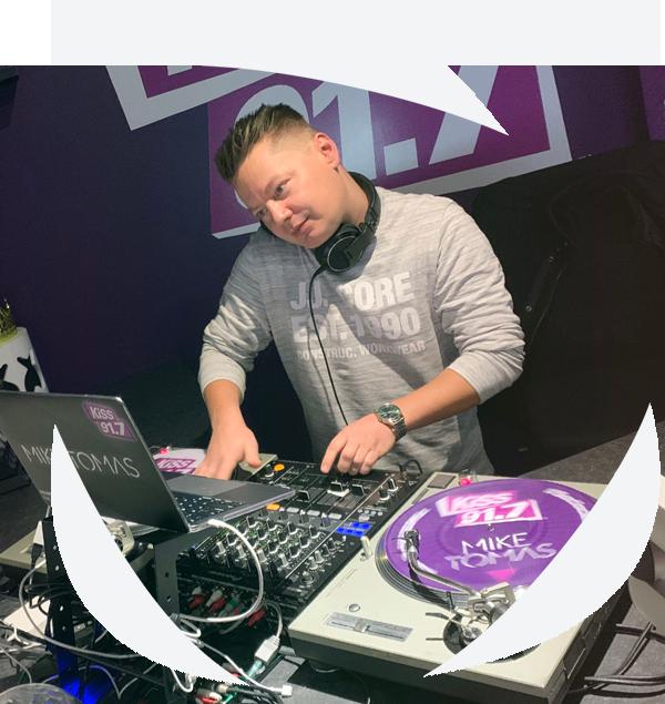 DJ Mike Tomas DJing at KiSS 91.7 in Edmonton, Alberta